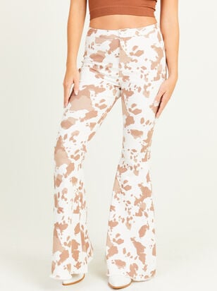 Cow Print Flare Jeans - Altar'd State